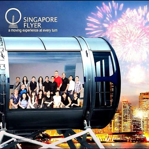A few of my colleagues & I enjoying ourselves on the #SingaporeFlyer #gf_singapore #singapore #tourists  (Taken with Instagram)