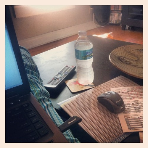 "my ""desk"" when I work remote 😏😏😏. also Chai sunning in the background (Taken with Instagram)"