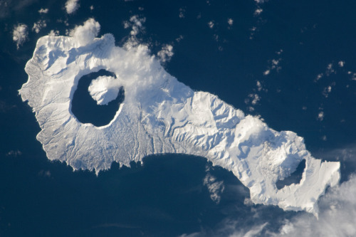 "fuckyeahvolcanoes:  Onekotan Island, Kuril Islands, Russia. NASA image. ""Snow cover highlights the calderas and volcanic cones that form the northern and southern ends of Onekotan Island, part of the Russian Federation in the western Pacific Ocean. Calderas are depressions formed when a volcano empties its magma chamber in an explosive eruption and then the overlaying material collapses into the evacuated space."""
