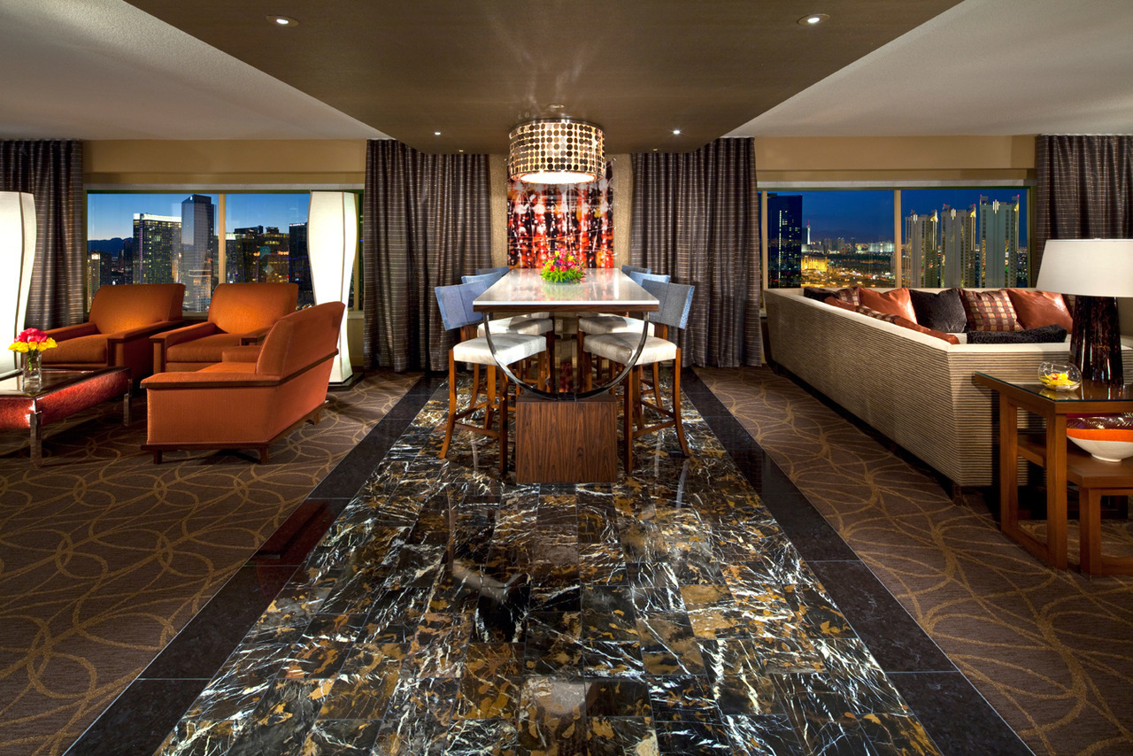 The Skyline Marquee Suite is designed to excite. Suites in Las Vegas don't get any better than this. The two-bedroom Skyline Marquee Suite boasts sweeping 180-degree views of the Strip. Designed for larger groups, these suites overflow with twice the luxury: large flat-screened HD televisions, oversized bar, extended living area with ample seating and dining space. They also feature a great room with media/living area and a large table for games or dining. A grand foyer separates two master suites, each with its own bathroom. It's safe to say your every wish will be exceeded. Book a new Skyline Marquee Suite today by clicking here.