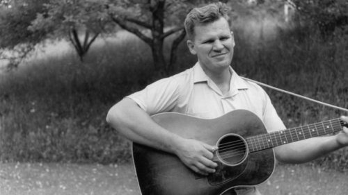 "Doc Watson - Live in Greenwich Village, 1962 Via Delta Slider, a beautiful half-hour of Doc at Gerde's Folk City, the epicenter of the NYC folk scene in the early 60s. Knowing the way that the folkies were back then, I'm sure that a lot of them came to the show armed with some bogus notion of ""authenticity"" — the blind geetar-picker from North Carolina's Blue Ridge Mountains! But as is the case with most so-called folk musicians, Doc was no backwoods primitive — the dude was sophisticated, a true artist. One listen to this set, wherein Watson blows the room away with machine gun precision, should be enough to convince anyone."