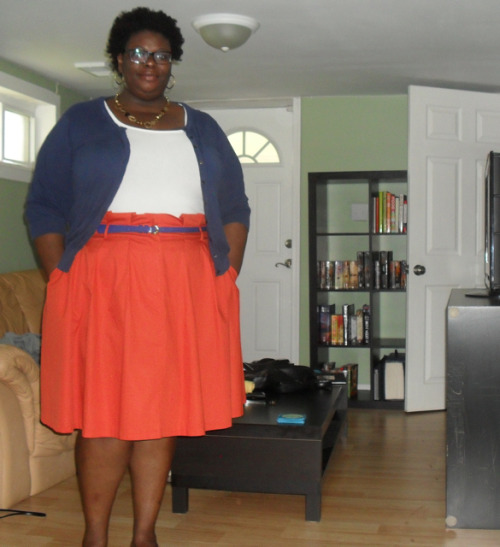 apostrophized:  Skirt: Ashley Stewart - Cardi/T-shirt/Belt: Old Navy - Necklace/Earrings: World Market And the crazy hair is all mine. This humidity is KILLING all my curls, and I actually don't even care for once. It's nappy and big and poofy and all over the place and I kinda love that. Silly day to wear this skirt, since it's windy out and the skirts moves everywhere. But I've been wanting to wear it again since… last year, I think. I love orange… and blue… together… even though they are the colors of a certain racist gang that dominates in the Pacific Northwest. But, as always, WHATEVS. My intern started today. She's from the Nederlands. I always feel bad for DC interns, they are impressed so easily when, in truth, they just fetch coffee and file papers. I can't be that kind of manager — I'd rather do the filing and let them do something meaningful. Hence why I am always pissed off by the end of the summer… :)