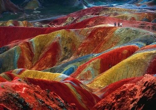 quincynessigsays:  This is a geological phenomenon known as Danxia landform. These phenomena can be observed in several places in China. This example is located in Zhangye, Province of Gansu. The color is the result of an accumulation over millions of years of red sandstone and other rocks.