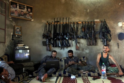 simply-war:  Free Syrian Army fighters sit in a house on the outskirts of Aleppo, Syria, Tuesday, June 12. AP photo.