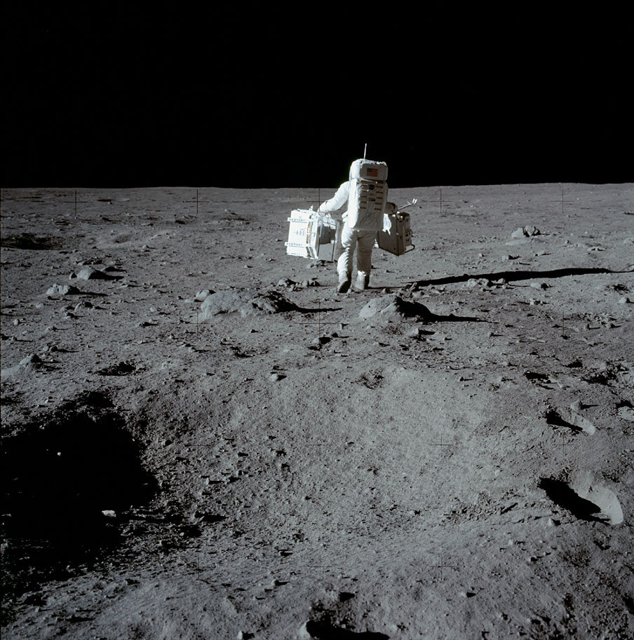 Buzz Aldrin carrying equipment on the moon. July 20th, 1969.