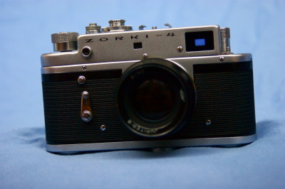 MY BABY! so this is a photo of my personal zorki 4 vintage rangefinder camera and the jupiter 8 50mm F/2… great fun and completely love the camera. it's a very different feeling shooting a rangefinder compared to shooting an SLR let alone a DSLR. However it serves it's purpose and i only really use it for street photography and will be posting many photos in the future.  the photo was take with two Yongnuo YN-560's and my sony A390. The backdrop was quite literally a bed cover thrown over my sofa!