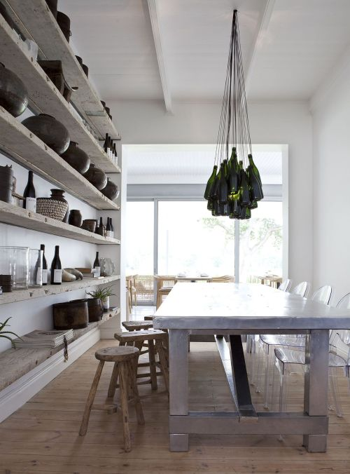 thebowerbirds:  Source: Maison Estate Amazing dining room! Love the metal table and the wine bottle chandelier, not to mention the open shelving! Perfect combination of contemporary and collected. Love it.