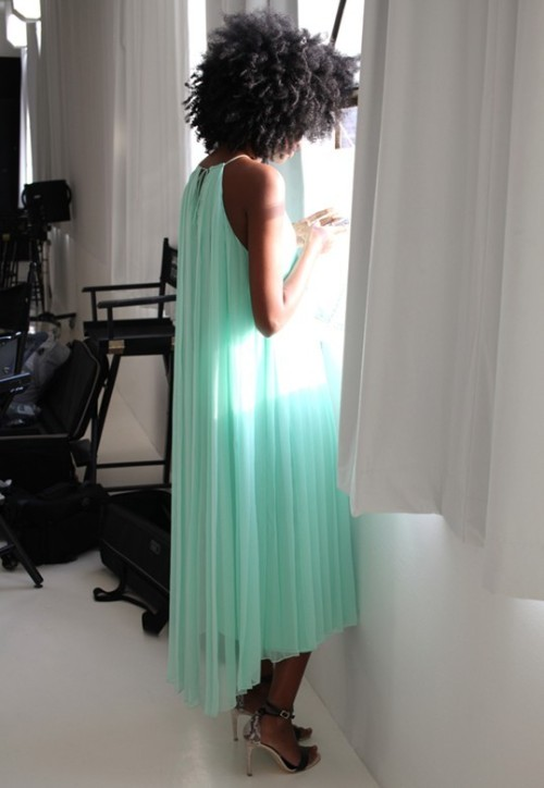 stylishlymine:  STYLE IS: AN AFRO HAIRED GODDESS DRAPED IN AQUA PLEATS!