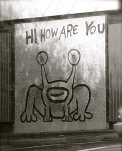 "This frog was painted in 1993 by daniel johnston a singer-songwriter which was once an album cover of his. You can find ""jeremiah the Innocent on the side of the sound exchange record store located on the ""Drag"" (21st and Guadalupe)."