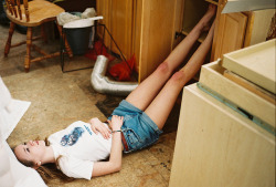 alveus:  legs in the cabinets by akimuby on Flickr.