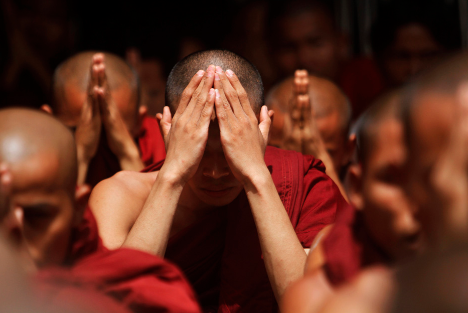 "Rakhine Buddhist monks pray for peace at the Sule pagoda in central Yangon June 12, 2012. The European Union said on Monday it was satisfied with Myanmar's ""measured"" handling of the Muslim-Buddhist violence that engulfed one of its biggest towns at the weekend, while the United States urged all ethnic groups to work at reconciliation. REUTERS/Minzayar"