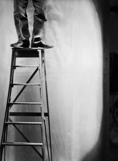 Legs and feet of a man on a ladder by Roger Parry, 1929Also