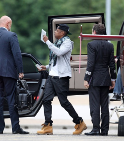 Jay-Z was flying solo, accompanied only by his bodyguard who was on hand to usher him safely into his waiting car.