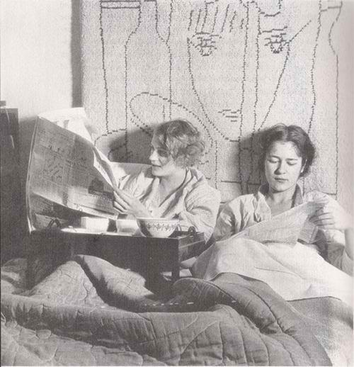 kallyn:  Lee Miller and Tanja Ramm in Miller's Paris studio having breakfast in bed in the company of a wall hanging by Jean Cocteau, by Theodor Miller, c.1931
