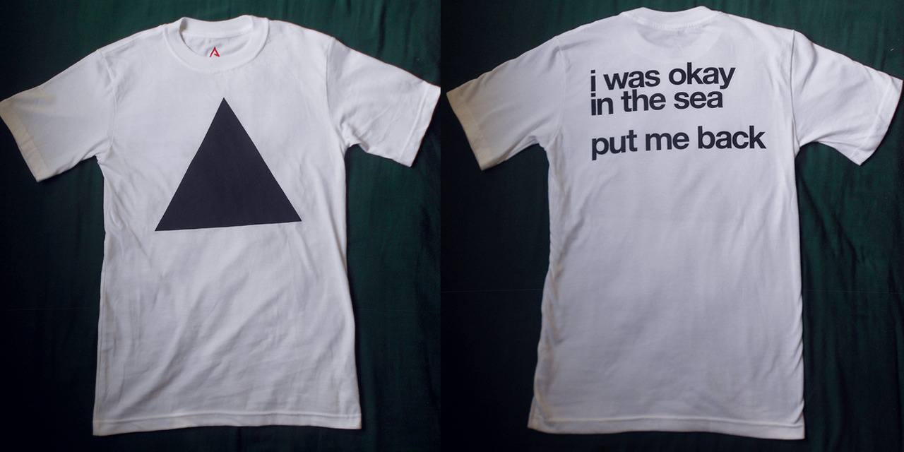 "New Shirt Available! White w/ black CRUNK JUICE triangle. On back: ""i was okay / in the sea // put me back."" Printed on Alta Gracia union-made shirts. Buy it here for $20."