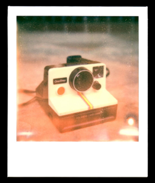 "Title: Polaroid sx-70 One Step Rainbow Camera Camera: Polaroid sx-70 Film: Impossible Project PX680 Color Shade This was my first attempt shooting with the sx-70 AND using Impossible Project's PX 680 film. The effect of the film gives off an artsy/vintage look to it, however, I find the film very unforgiving. After taking a few more shots, I noticed the films were slightly overexposed. Apparently the first few seconds of the development process is very crucial, it's very sensitive to light. After reading a few tips and tricks from Impossible Project's website, I was able to keep my films from being overexposed. Overall, I think the film is ""somewhat"" difficult to use, basically it's a give and take and you never know the outcome of the photo until it is developed, BUT, it is a real rewarding feeling if the photo turns out successful. What I think attracts die-hard photographers and artist to use this product(s) is the challenge and the anticipation it gives off. The end results of a photo/film is very unique and unusual, and it is ONE of its kind, in my opinion, not even Photoshop can mimic it. Photographers, I do recommend using this product!"