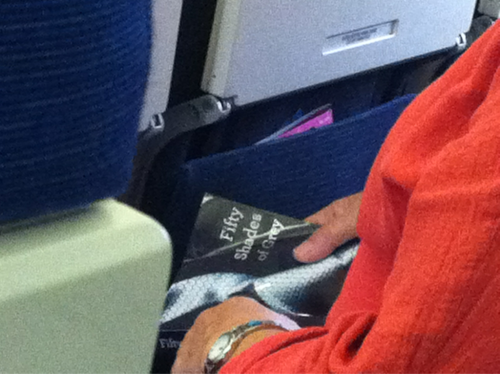 Lady on the plane from Chicago to Atlanta reading 50 Shades of Grey.