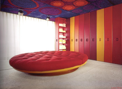 Carpet on the ceiling… I think yes!  Bedroom with a round bed designed by Kunststoffhaus, 1968.
