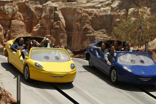 "Cars Land opens at Disney's California Adventure on June 15, and our resident theme-park expert Brady MacDonald describes it as ""like stepping into a real-life version of the fictional town of Radiator Springs from the 2006 animated movie.""  The new land features three rides, two that are wonderful and one that's less so. The surprisingly spry Mater's Junkyard Jamboree is a classic whip ride on a spinning teacup platform that packs a wallop. The disappointing Luigi's Flying Tires is a docile re-creation of the 1960s Flying Saucers ride in Tomorrowland. And Radiator Springs Racers combines a dark ride with a drag-race finale in one of the best attractions you'll find at any Disney park.  Disney fans, you may want to admire Cars Land from afar (this photo gallery might help) for a while. ""Disney officials are already preparing for waves of visitors to turn Cars Land into an ocean of humanity during the first few months following the grand opening,"" MacDonald notes, and multiple-hour ride lines are to be expected. Photo: The Radiator Springs Racers ride. Credit: Mark Boster / Los Angeles Times"