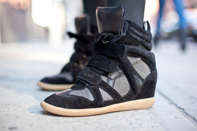 "Isabel Marant Wedge Sneaker By Jauretsi The word ""sneaker wedge"" is a term that used to give me the creepy crawlies. Simply put, it was the type of thing I imagined other girls buying. Suddenly, I started hearing about these Isabel Marant sneakers word of mouth in the last year. Given the fact she is one of my favorite designers, only Isabel can make me bend. It seems like cool chicks like Gisele Bundchen to Beyonce have been rocking them with grace and swagger. Street blogger William Yan called them out with this snapshot while covering New York's Fashion set.  [MORE] Overall, the wedge sneaker trend is growing fast, with sales blowing up in recent weeks (as opposed to earlier this year). Currently, there are 7,000 pairs of wedge sneakers available on the marketplace. About a third of all wedge sneakers sold on eBay are Isabel Marant (the highest sold at $1,435 for a pair of pink and black Isabel Marant Willows), which means she's king of the mountain… or um, queen, that is. There's some great starting bids this week, so get in, before they get out. (Photo Credit: William Yan)"