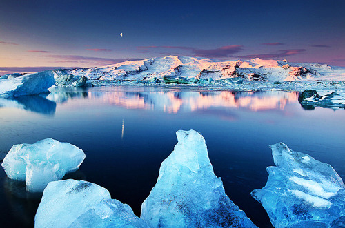 acureforreality-:  Dormant Giant - Öræfajökull reflected in Jökulsárlón, Iceland by orvaratli on Flickr.