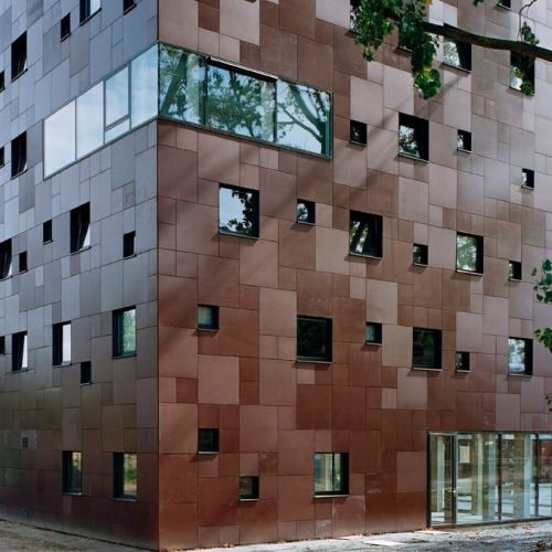 enochliew:  Blok 1 by Group A The façade is covered by panels with a slightly differing finish, creating a subtle pattern.