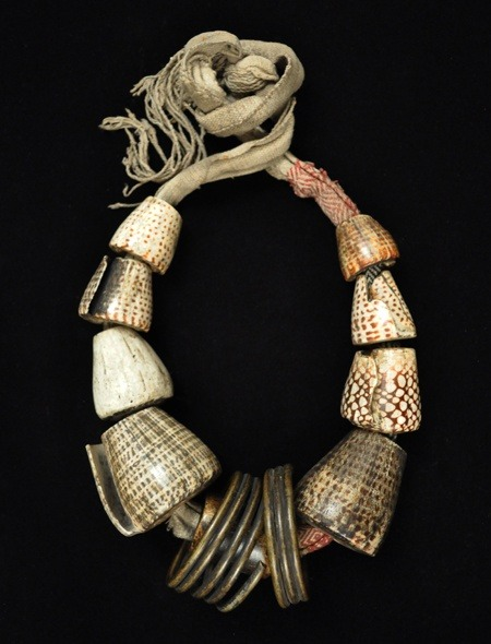 thegiftsoflife:  Philippines | Akusan (woman's belt) Bontoc. Conus shells, coiled brass, woven cotton fabric, human bone. Early 20th century