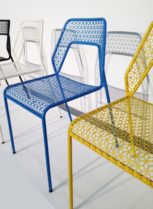 andymurraydesign:  Blu Dot: Hot Mesh Chair http://www.bludot.com/ Shown at ICFF the new Hot Mesh Chair from Blu Dot brings pattern and color into the basic dining chair. Casual and modern, the chairs are available in classic black or white, or these trending shades of yellow and blue. Their hexagonal designs decorate not only the chairs but also the surfaces onto which their shadows are cast. The all-around story is playful and whimsical, fitting for the Blu Dot brand.