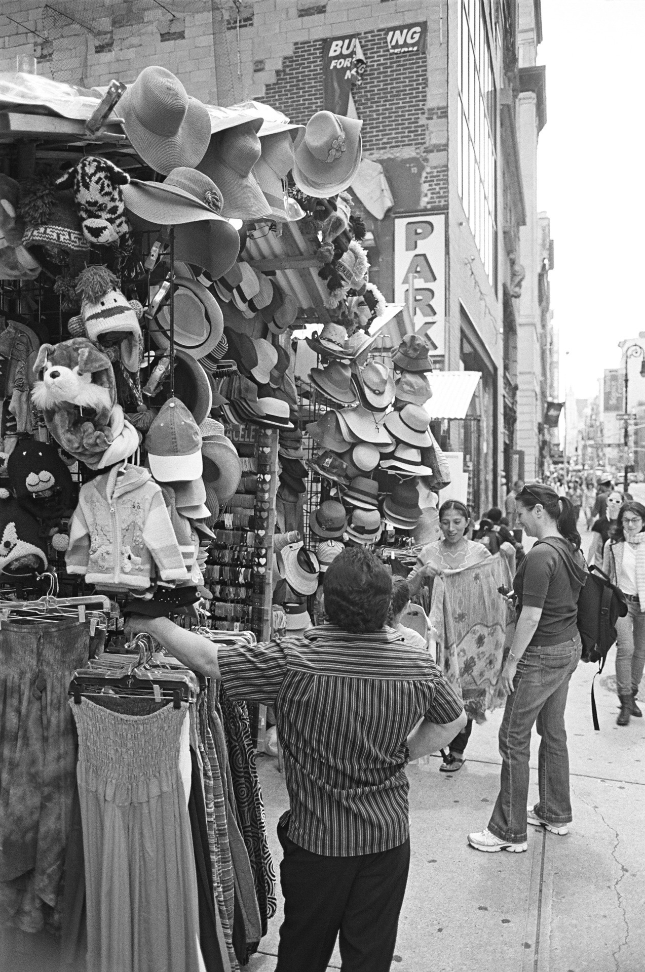 """i hope you have a lot of nice things to wear"" noho, nyc. (Nikon FM2)"