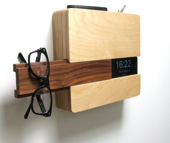 iPhone Charging Station And Comfortable Shelf In One kate, digsdigs.com If you had a long day and want to relax right after com­ing home, this piece would help you to do that. The But­ler by design­er Cur­tis is iPhone stor­age or charg­ing sta­tion that even has a place for your wal­let, keys, and other stuff that yo…  If you had a long day and want to relax right after com ing home, this piece would help you to do that. The But ler by design er Cur tis is iPhone stor age or charg ing sta tion that even has a place for your wal let, keys, and other stuff that you need to store imme di ate ly after a long day. The piece is made of wal nut and Baltic birch lam i nat ed ply in San Diego, CA. In the back side there is a rout ed out sec tion for charg ing your iPhone and exten sion cord in case your mount ing area on the wall is not next to an out let. Every thing is for you and your com fort! http://flpbd.it/Z12ii