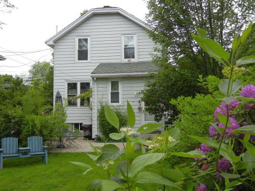 JUST LISTED - 6284 Yukon Street in a quiet West End Halifax neighbourhood. You have never seen old meeting new in such a practical and classy way until you see this charming home. Located on a quiet cul de sac in a family friendly neighbourhood, this home boasts its old charm with many new upgrades. With natural gas, installed in 2009, the annual heating bill is exceptionally low. What`s more, the blown in wall insulation, completed in 2007, and new roof installed in 2004, makes this home even more energy efficient. Enjoy the relaxing atmosphere in the main living area, which has a wood insert fireplace, bar-like kitchen/dining area and large open foyer. Take a stroll into the private backyard, teeming with shrubs, fruit trees, vines, evergreens and perennials, or walk two streets away to bustling Quinpool road shopping and dining. 4 Bedrooms upstairs for young families! To make this property that much more affordable, it also boasts an R2 zoning, coupled with monthly rental income. This really is the way to live practically, but to do so with style.