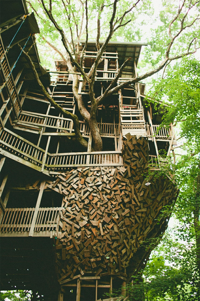 The Minister's Treehouse in Crossville, Tennessee is a 100ft structure built by minister Horace Burgess from the early 1990s through 2004. The entire building wraps around a giant tree and was built completely without blueprints, sprawling to an estimated 10,000 square feet inside, including a four-story swing set.