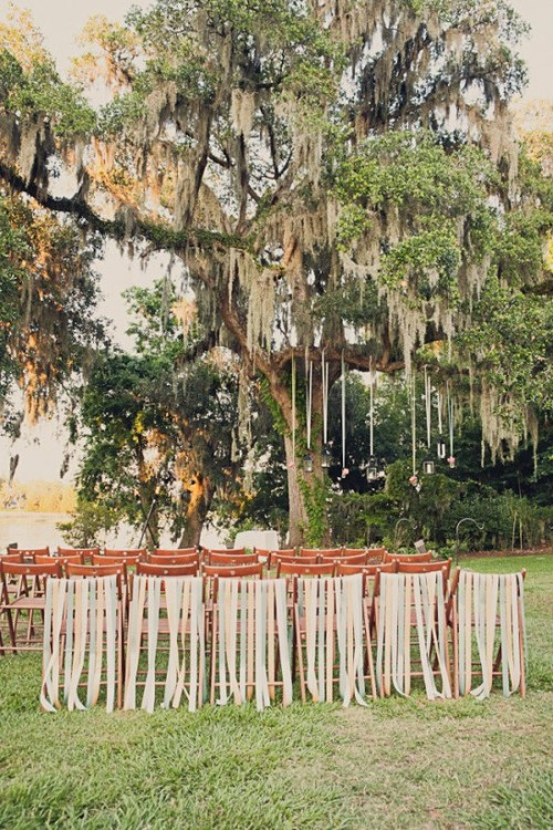 bride2be:  beribboned chairs mixed with spanish moss at this gorgeous charleston wedding; photography by doveandsparrow.com