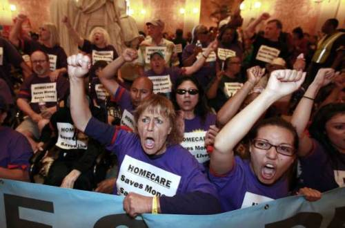 Protesters fight against cuts to homes for elderly & disabledDemonstrators flooded the Sacramento Capitol rotunda in California on June 13 to protest cuts to home care for the elderly and disabled. Police arrested 43 people. Sean Kennedy, a spokesman for the California Highway Patrol, said they were cited for misdemeanors and released. It was the second protest in two days in which demonstrators were arrested by the California Highway Patrol, which provides security at the Capitol. Ten people were arrested on Tuesday after blocking the entrance to Gov. Jerry Brown's office. Brown has proposed saving $225 million from the In-Home Supportive Services program through cuts that include a 7% reduction in hours of care. The cut would have a ripple effect because counties and the federal government would withdraw matching funds, leading to a total reduction of about $800 million. Source