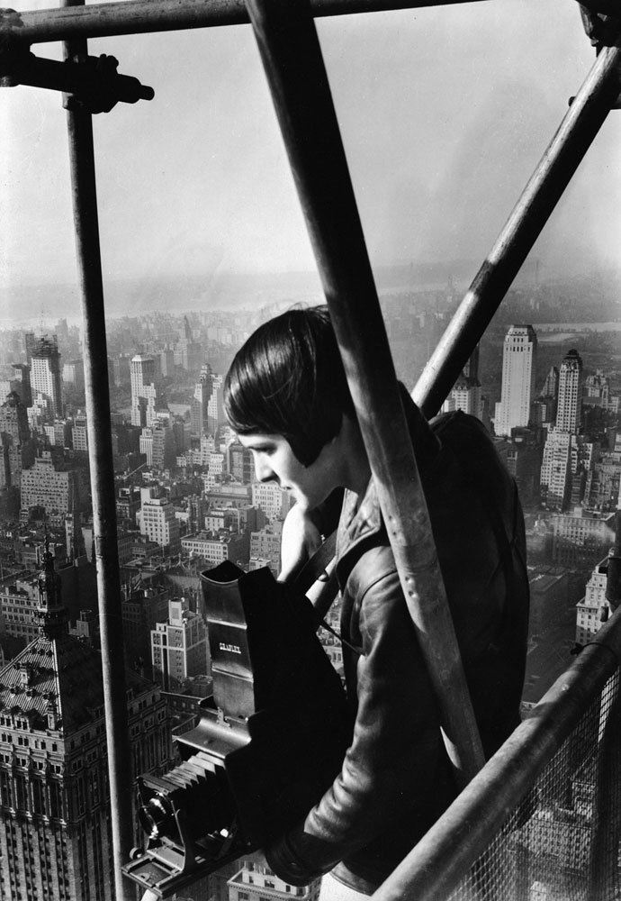 "Margaret Bourke-White, Portrait of Myself  ""By some special graciousness of fate I am deposited — as all good photographers like to be — in the right place at the right time. Go into it [photography] as young as possible. Bring all the asset you have and play to win."""