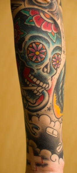 This is my intubated sugar skull. My entire sleeve is nursing inspired, since I'm a nurse. This particular piece was to represent my days in the Intensive Care Unit. My tattoos were done by the wonderful Tracy Zumwalt at Anchor Tattoo in Seattle, Washington. I love his work so much, that he's the only one that has tattooed my arms! -xzombienursex