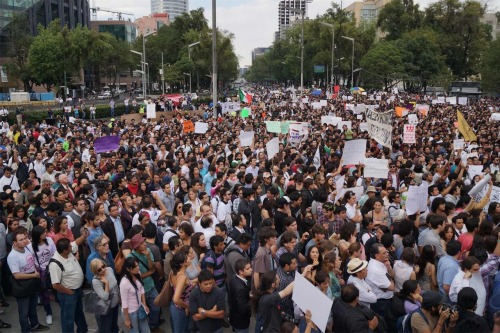 "A student upsurge in MexicoJune 14, 2012 An unexpected wave of protests led by university students has broken out in cities across Mexico, centered on the media's promotion of presidential candidate Enrique Peña Nieto of the Institutional Revolutionary Party (PRI), the party that ruled Mexico for 70 years until 2000. Students from different social backgrounds, and from both public and private universities have for the first time formed a united front in leading a nonviolent struggle of conscience against mainstream media conglomerates Televisa, TV Azteca, Milenio and Radio Formula, including their anchors, broadcasters and journalists. But the protests' main focus on the media's telegenic chosen candidate, Peña Nieto. Anti-Peña Nieto sentiment publicly began to make headlines at the Universidad Iberoamericana on May 11, when the visiting candidate was loudly and embarrassingly mocked by students. The candidate's visit to the campus was previously canceled on two occasions—apparently out of fear that he would stumble, as he had at the International Book Fair in Guadalajara last December, when he was unable to remember the authors of books that had been important to his life. Once he arrived on campus in May, Peña Nieto was forced to leave through the back door as students ran him off the premises chanting: ""Out ignorant, out Peña Nieto, the Ibero doesn't want you!"" In a university that mostly caters to the upper middle class and wealthy, the protest was another unexpected blow to the PRI candidate's already flawed reputation. With the help of a friendly media, Peña Nieto and the PRI immediately retaliated in accusing Josephina Vasquez Mota of the right-wing National Action Party (PAN) and center-left candidate Andres Manuel Lopez Obrador of the Progressive Front of jointly conspiring against him by accusing the two of fomenting intolerance. When the media echoed those claims, 131 students who had participated in the protest posted a video in which they showed their student IDs. This led to the launch of a Twitter feed, #YoSoy132—I am 132. Source"