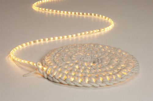 A very cool crochet rug. Thick rope/yarn crocheted around rope lights.