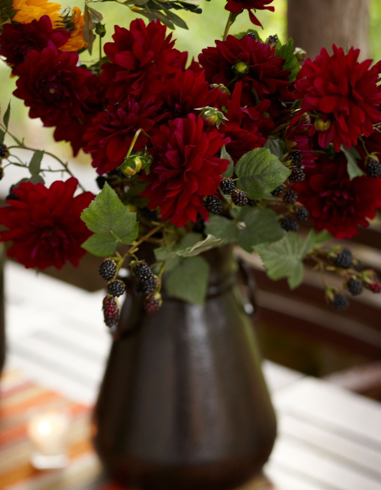potterybarn:  A bouquet of lush red dahlias and blackberries