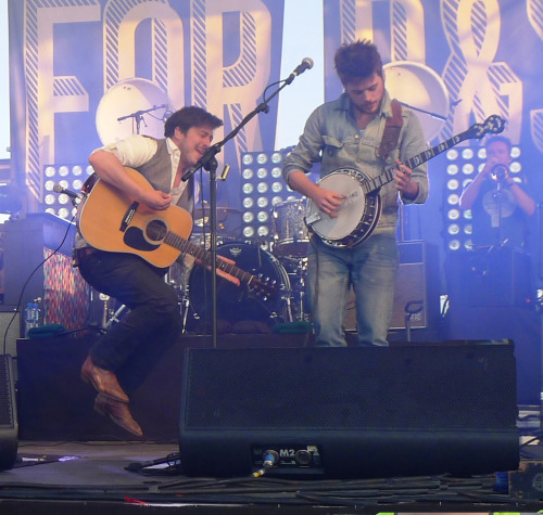 buticantmovethemoutainsforyou:  Marcus Mumford and Winston Marshall performing at the Gentlemen of the Road Stopover in Salthill Park, Galway on the 9th of June 2012. —one of the many photos i took at the gig. best night of my life. <3