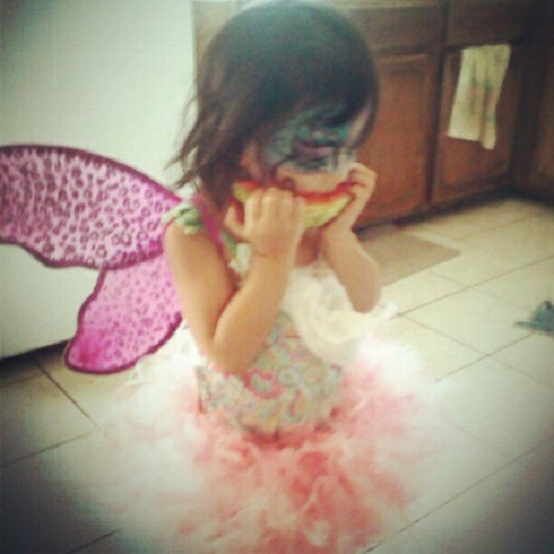 simplymetta:  My little #fairy chowing down a #watermelon (Taken with Instagram)  these kids know…