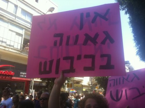 "here-lies-andalusia:  sura93:  Participants in Tel Aviv's Gay Pride parade protesting ""pinkwashing"" by Israeli government hold sign which reads ""There's no pride in occupation,"" June 8, 2012 (photo: Roee Ruttenberg)  Yalla!"