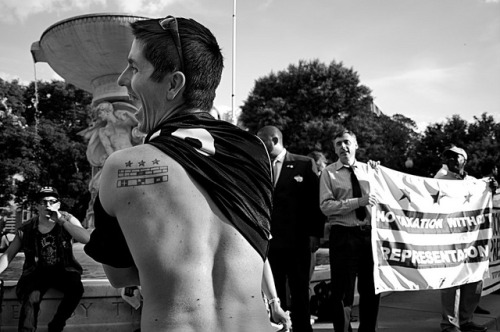 anelegantweapon:  DC Streets: Statehood Rally on Flickr. Tattoos at a DC Statehood rally.