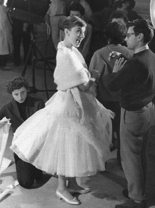 Audrey Hepburn with Richard Avedon on the set of Funny Face, 1956