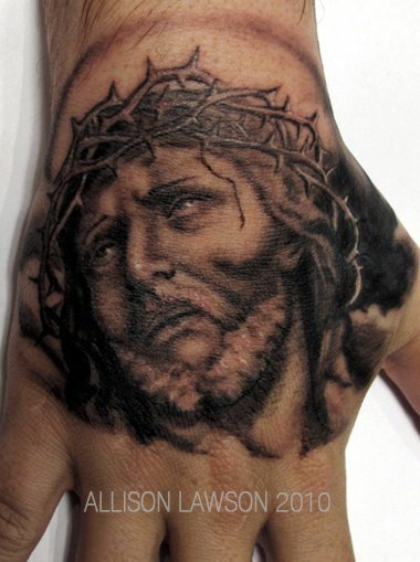 Jesus tattoo on hand by Allison Lawson.