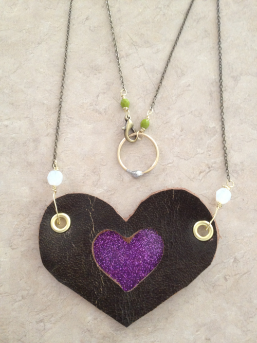 Reclaimed Heart necklace in purple Reclaimed leather from a FollyBeach armchair. Glitter vinyl Brass and facetted beads www.JaneticsInk.com