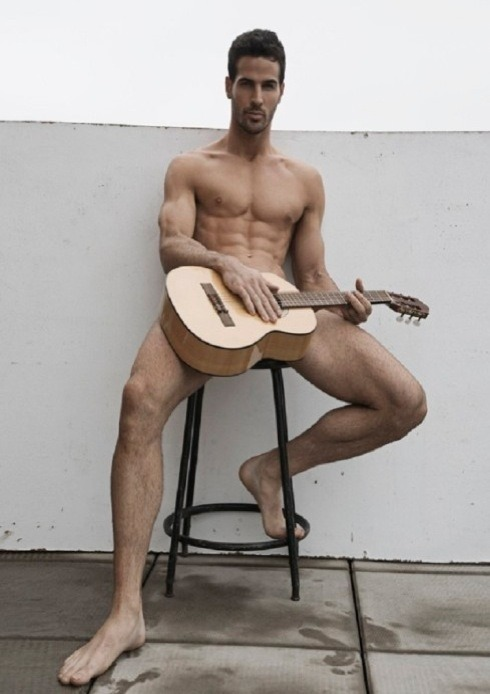 dnamagazine:  We wouldn't mind watching Clark play the guitar in the nude… Click through for more sexy images by Rick Day!