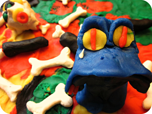 """The Lonely Monster Just Wants to Make Friends""(A deluxe extra special CLAY Daily Doodle) He's just a lil' monster, he only wants to make some friendsBut no matter who he meets, he knows how it always ends.They'll come into his lair, and he'll come out to tell them ""Hi!"" :-)But then they'll look delicious, and then they'll have to die :'-( Before he can get to know them, he strips their meat from their bonesDoesn't even ask for their email, or if he can text them on their phonesHe keeps saying he wants a buddy, someone with he can pal aroundInstead he pushes friendship away, by smearing their brains on the ground. When the frenzy is all over, he tries to rationalize and think:""Me bet a friend wouldn't be better, 'den all da tasty blood me drink!!""But he knows that's just a lie, because it simply hurts to be aloneSo he sobs quietly in the dark… wishing for a friend to call his own :'-/ Posted 6/14/2012 Wanna appear in your very own Daily Doodle?  CLICK HERE!FAQ  TWITTER  FACEBOOK  SOCIETY6"