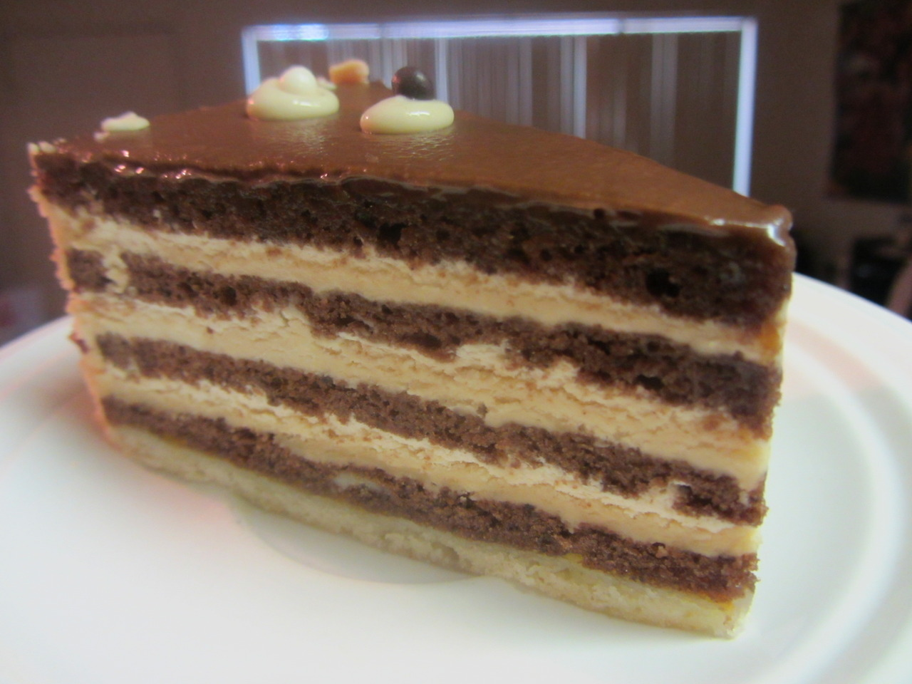 fighting-my-reflection:  Caramel Cream cake from Konditorei, an Austrian pastry cafe I've been meaning to visit before my stay in Davis comes to an end.