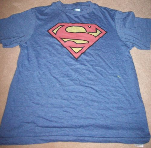 July the Second! Another Superman Shirt! I believe this one is either from Walmart or Old Navy. I have found that generally these two stores have at least one shield shirt and one other shirt. Although the other is sometimes superman, and sometimes JL or DC characters. Its always a touch and go sort of thing. =)